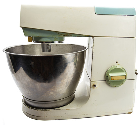 old 70s vintage tabletop kitchen mixer against white background