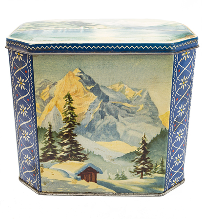 Isolated metal box with painting of a mountain winter scene Stock Photo