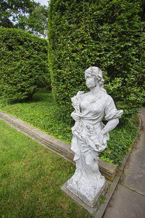 Grec inspire statue in formal green garden