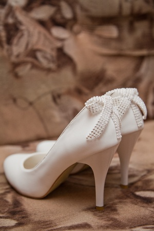 pastes: White shoes with a bow Stock Photo