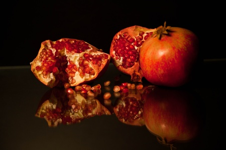 Pomegranate on a black background photo