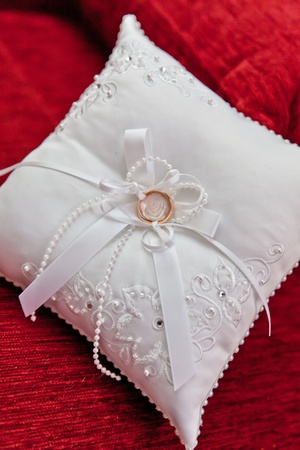 Wedding rings on a small pillow Stock Photo - 10649120