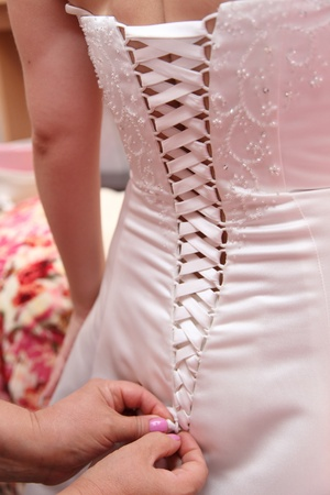 bodice: Lacing on a dress of the bride
