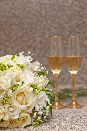 Wedding bouquet and wine glasses with champagne