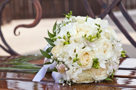 Wedding bouquet on a bench Stock Photo - 10699279