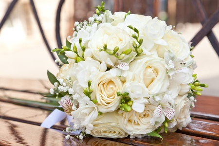 rose tree: Wedding bouquet on a bench