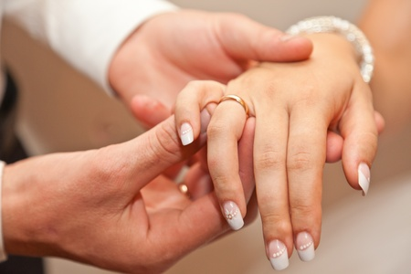 The groom dresses a ring on a hand of the bride Stock Photo