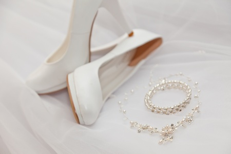White shoes and costume jewellery photo