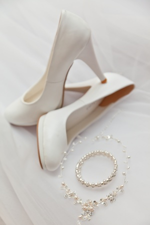 White shoes and costume jewellery
