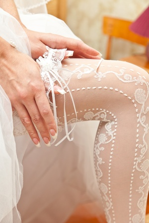 Garter on a foot of the bride