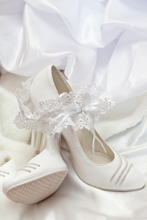 White wedding shoes and garter Stock Photo