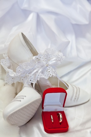 Wedding footwear, garter and wedding rings Stock Photo - 11688797