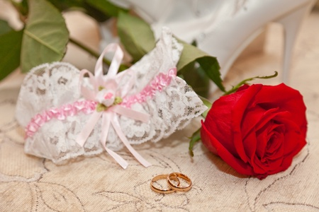 Garter, rings and a red rose Stock Photo - 12436181