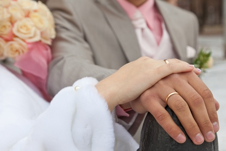 Hands of the groom and the bride with wedding rings Stock Photo - 12436163