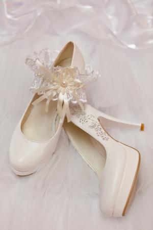 Wedding footwear and garter photo