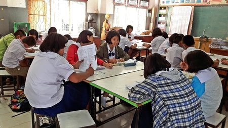 UDONTHANI, THAILAND – DECEMBER 21, 2018 :  Asian countryside students,  they are studying in their classroom,  see them at BAN DONG NOI school in UDONTHANI province THAILAND.