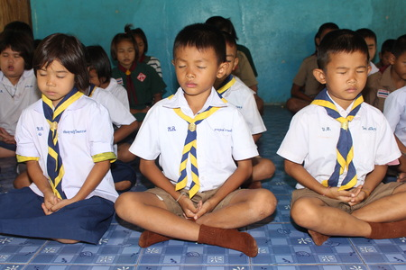 UDONTHANI, THAILAND – JULY 5, 2018:  Students,  sit for training the concentrate,  be morality of Buddhism,  that they do everyday before study in afternoon. Editorial