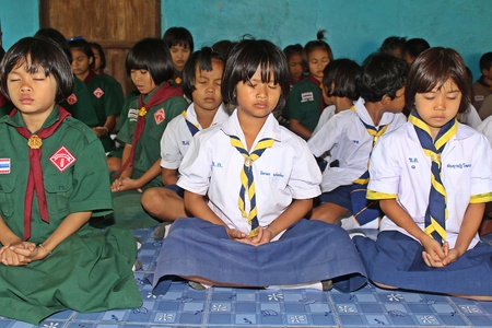 UDONTHANI, THAILAND – JULY 5, 2018:  Students,  sit for training the concentrate,  be morality of Buddhism,  that they do everyday before study in afternoon.