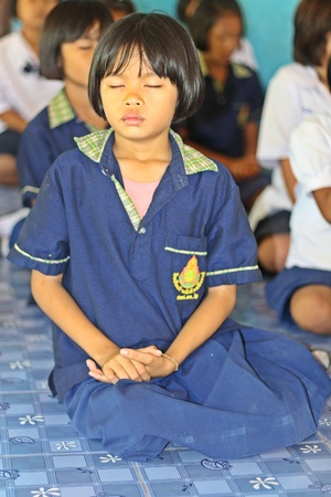 UDONTHANI, THAILAND – JULY 9, 2018:  Students,  sit for training the concentrate,  be morality of Buddhism,  that they do everyday before study in afternoon. Editorial