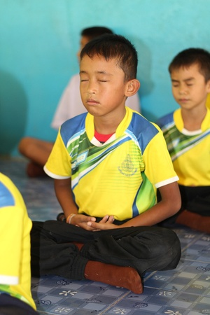 UDONTHANI, THAILAND – JULY 9, 2018:  Students,  sit for training the concentrate,  be morality of Buddhism,  that they do everyday before study in afternoon.