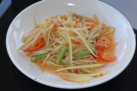 Thai food. it's papaya salad. for example that the important component is papaya, lemon, chili. Thai people call SomTum. Stock Photo