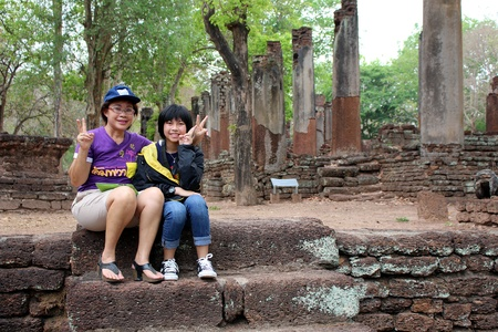 KAMPHAENGPHET, THAILAND – JULY 14, 2018:  Asian child and her guardian enjoy together in their travel time,  see them at KAMPHAENGPHET province THAILAND. Editorial