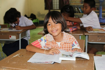 UDONTHANI, THAILAND – SEPTEMBER 12, 2018 :  Asian countryside student,  she is studying in her classroom,  see her at BAN HUA KUA MUEAD AE school in UDONTHANI province THAILAND.