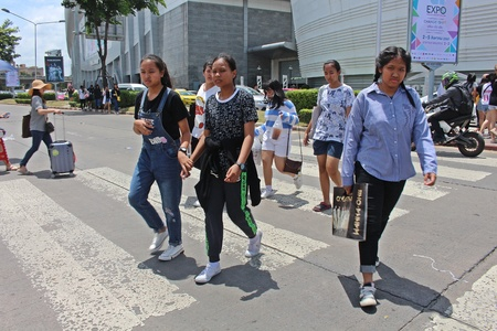 NONTHABURI, THAILAND – OCTOBER 14, 2018:  Thai people are walking to cross the street at MUANG-THONG-THANI,  be area that the traffic is crowded in NONTHABURI province THAILAND.
