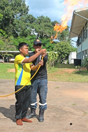 UDONTHANI, THAILAND – NOVEMBER 16, 2018:  Primary students share the activity with the expert group together about to put out the fire,  see them at BAN HUA KUA MUEAD AE school.
