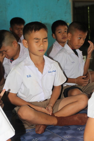 UDONTHANI, THAILAND – AUGUST 8, 2018:  Students are training the concentration,  be morality of Buddhism,  they do every day before study in afternoon. 報道画像