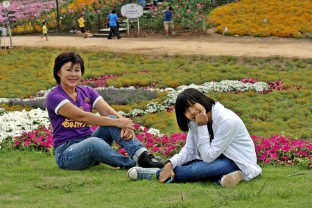 UDONTHANI, THAILAND – DECEMBER 6, 2018:  Asian child and her guardian enjoy together in their travel time,  see them at UDONTHANI province THAILAND.