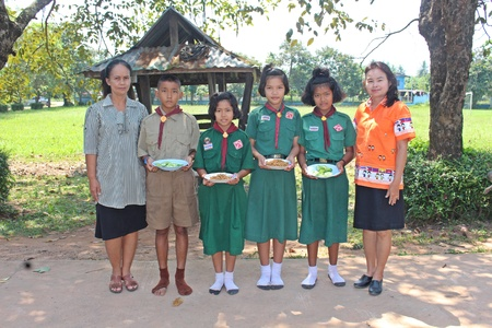 UDONTHANI, THAILAND – DECEMBER 12, 2018:  Thai children group and two teachers pose a photograph together,  before will do the activity,  see them at BAN-NONG-WANG-NON-KHI-LEK school.
