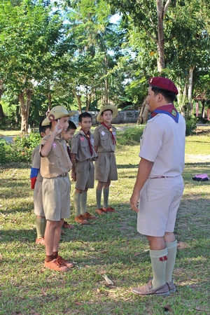 UDONTHANI, THAILAND – DECEMBER 13, 2018:  Asian boy-scouts,  be standing in row and report some data to their teacher,  see them at BAN NONG WANG NON KHI LEK School in UDONTHANI province THAILAND.