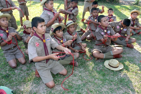 UDONTHANI, THAILAND – DECEMBER 19, 2018:  Asian boy-scouts,  they are doing the activity about knotting by rope,  see them at BAN NONG WANG NON KHI LEK school in UDONTHANI province THAILAND.