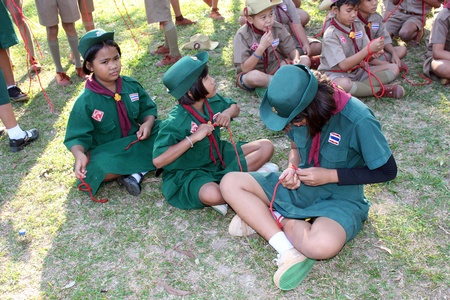 UDONTHANI, THAILAND – DECEMBER 19, 2018:  boy-scouts and girl-scouts,  they are doing the activity about knotting by rope,  see them at BAN NONG WANG NON KHI LEK school in UDONTHANI province THAILAND.