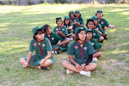 UDONTHANI, THAILAND – DECEMBER 19, 2018:  Asian girl-scouts,  they are doing the activity about knotting by rope,  see them at BAN NONG WANG NON KHI LEK school in UDONTHANI province THAILAND.
