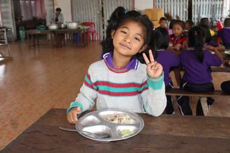 UDONTHANI, THAILAND – JANUARY 31, 2019:  Lunch time,  Thai student is enjoy in lunch time at her school,  see her at BAN NONG WANG NON KHI LEK school. Editorial