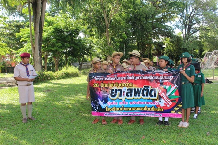 UDONTHANI, THAILAND – JUNE 26, 2019:  Thai boy-scouts hold the large sign and pledge that will not get involved to drugs,  see them in WORLD ANTI-DRUG DAY at UDONTHANI province THAILAND.