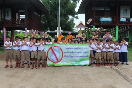 UDONTHANI, THAILAND – JULY 4, 2019:  Thai teachers and students pose for take a photograph, then pledge that will reduce and stop using plastic bags for be not problem to their school area.