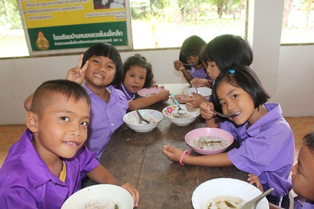 UDONTHANI, THAILAND – OCTOBER 10, 2019:  Lunch time,  Thai students are enjoy in lunch time at their school,  see them at BAN NONG WANG NON KHI LEK school.