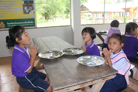 UDONTHANI, THAILAND – OCTOBER 4, 2019:  Lunch time,  Thai students are enjoy in lunch time at their school,  see them at BAN NONG WANG NON KHI LEK school.