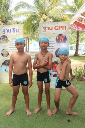 UDONTHANI, THAILAND – OCTOBER 6, 2019:  Each boy wears swimsuit and pose for a photograph together,  before they have will swim in the pool.
