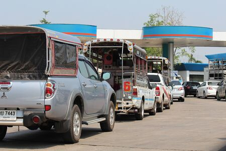 UDONTHANI, THAILAND – JANUARY 4, 2020:  The cars are in row for add fuel,  see these at oil station on weekend,  they will drive their car to tour during this holiday. Redakční