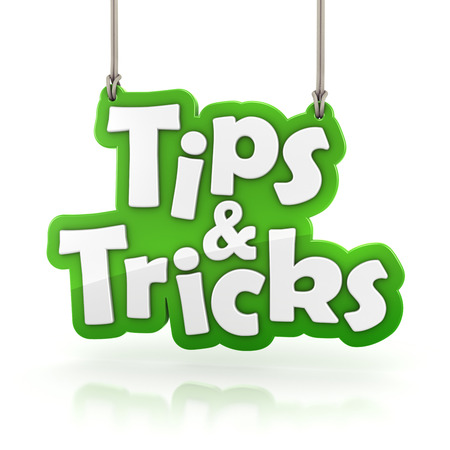 Tips and Tricks green text icon hanging isolated on white with clipping path photo
