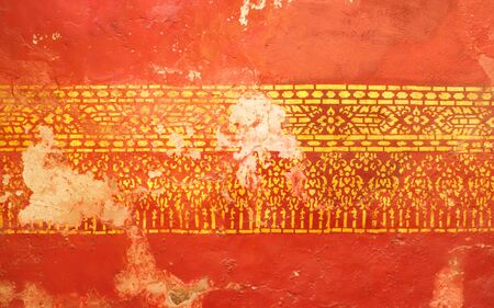 The original form was destroyed or broken in some parts on the walls of the old Buddhist temple. The original was painted with gold and red, which dark  gold showed that it was destroyed naturally.