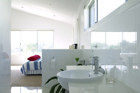 Modern bedroom with en-suite bathroom photo