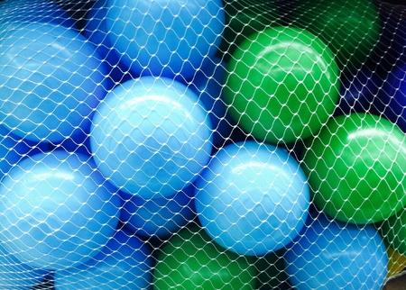 red: Bola de color con la red en los ni�os parque de juegos Foto de archivo
