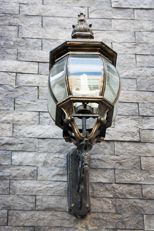 close up vintage street lamp style with LED lighter on brickwork wall Stock Photo - 28284624