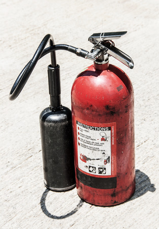 foam safe: old poertable Red fire extinguisher outdoor