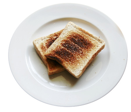 burnt toast: Burnt toast bread slice on dish ,isolated over the white backround